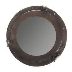 A porthole mirror lends a nautical touch in the coolest way. | $121