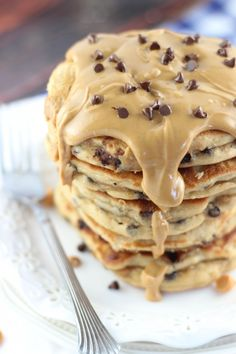 Peanut butter chocolate chip pancakes with peanut butter syrup