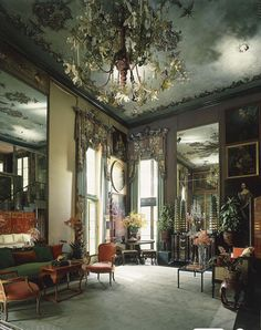 This photo, which is believed to date to the 1980s, shows a corner of the drawing room at Dawnridge. The lambrequins over the windows were painted to resemble tooled leather, and Duquette made the chandelier using specially blown Venetian-glass lilies. Tall mirrors and a ceiling painted like the sky made the sizable room seem even larger.