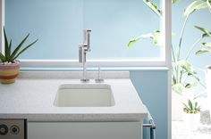 Perfect for entertaining, this faucet and bar sink double as a modern sculpture.
