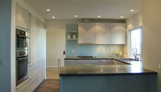 Gallery : Modern | Caesarstone; concrete counter with blue/gray cabinets