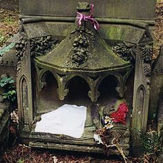 Infant grave... 1873, but someone still cares enough to keep a warm blanket and decorations on the stone