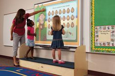 Blackboards and whiteboards are designed with the teacher's comfort in mind. The Jonti-Craft iRise Standard Interactive Whiteboard Step is here. Preschool Supplies, Preschool Crafts, Preschool Classroom, Kindergarten, Super Hero Training, Childrens Step Stool, Tractors For Kids, Kitchen Step Stool, Kindergartens