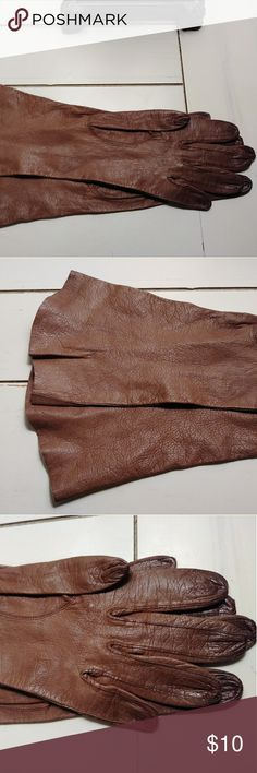 Vintage Leather Brown Gloves These were passed down to me and they are too small for my hands. They would be lovely for anyone that appreciates vintage clothing. These are small and have stood the test of time for sure. They have a stretch to them that may be from the age. They are for petite hands. They deserve to be worn or given a home that can take these treasures in.  I am happy to answer any questions and also open to offers.  Thank you for looking and Happy Poshing! Accessories Gloves…