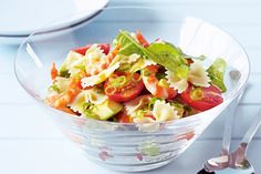 Bright baby tomatoes stand out in this tasty prawn pasta salad.