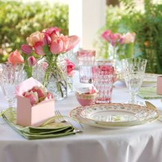 Tickled Pink Tea Table includes a short slide show of a table setting, floral arrangement, place card holder, and favor boxes