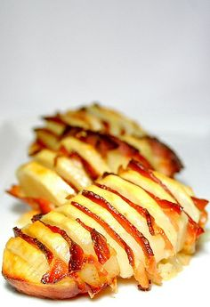 All you do is peel whole potatoes, cut them all across, not too thin, and not all the way through, sprinkle with some salt, but not too much, the bacon is salty. Then fill with small bacon slices in between. Bake in a pan with some oil until potatoes are fully cooked, and serve!...