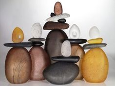 Melanie Guernsey Leppla and her Glass Sculptural Cairns (stones). Choose one or more to create an ensemble. Shown in red and gray colors they have three to five pieces per Cairn. Cairns have held deep significance for millennia. These Cairns, born of glass in heat and light, capture a brief moment in time when the elements are in balance. Each unique composition represents accomplishments, knowledge and experience gained, difficulties overcome and guidance for pathways yet to be traveled…