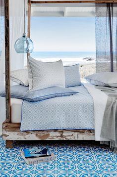Coastal Chic | blue and white floor tiles | blue sheets | ocean view | modern stylish bedroom