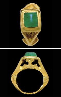 A ROMAN GOLD AND EMERALD FINGER RING   CIRCA 3RD CENTURY A.D.   The solid cast hoop flat on the interior, the lower part ornamented with cut outs and ending in volutes, the triangular shoulders open, with openwork foliate decoration on either side, the square bezel set with a cabochon emerald