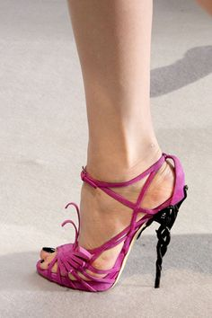Christian Dior by John Galliano, these sandals have heels made to look like intertwined stems and pastel-colored strappy.