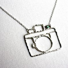 Adorable necklace for all you photographers out there.