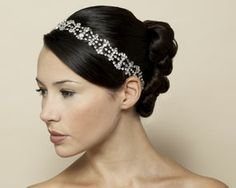 Momma wants me to wear a headband like this for my wedding.  Not sure if it will go with the veil but I like it!