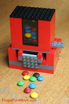 Make a real LEGO Candy dispenser! A fun LEGO craft and a great way to use up the extra candy laying around the house!