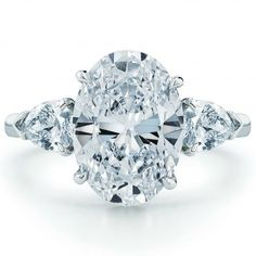 Kwiat oval engagement ring with pear sidestones. Maybe someday.