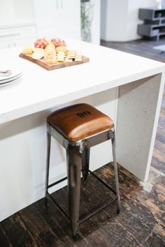 Simple and easy DYI . Add a leather padded seat to your tolix reproduction stools. You can stencil numbers or initials for an industrial look