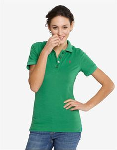Polos were trendy in women's fashion in the early 2000's. Preppy, girly styles became popular after the androgynous looks of the 90's.