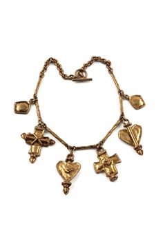 Features: - 100% Authentic CHRISTIAN LACROIX. - Iconic emblem charms: diamonds, crosses and hearts. - Signed CL at the back of the cross and hearts. - Toggle loop closure. - Some darkening and wear on the hardware (priced accordingly). - Good vintage condition.  Measurements: Height: 1 7/8 inches (4.76 cm) biggest charm Wearable Length: 15 2/8 inches (38.73 cm)  **This necklace will be shipped via Priority Shipping with tracking number.  Please convo me for any queries and additiona...
