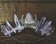 this crown features glass-like polished clear quartz, polished amethyst in varying shades of lilac and violet, and a spectacular amethyst spirit quartz specimen in the center of a silver moon. amethyst spirit quartz is a fantastic healer! it activates the Spirit Quartz, Mermaid Crown, Diy Crown, Goddess Costume, Diy Crystals, This Is A Book, Circlet, Mo S, Fantasy Jewelry