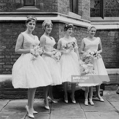 English novelist Jackie Collins (1937 - 2015, left) as a bridesmaid at the wedding of actress Adrienne Scott (aka Adrienne Fancey) and England rugby trialist and Wasps forward Gordon Benson, London, UK, 23rd August 1958.