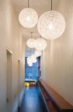 High ceiling in a dark hallway???  Light it up with some fabulous big lightshades!