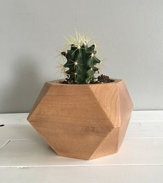 Hand made solid wood vase. Perfect for succulents or cacti. Made from maple that has been clear coated for protection.  --> Made from solid maple --> Recommended for succulents or cacti that do not require much water --> Measures approximately 5 wide x 5 thick x 4 tall --> Hole measures approximately 3 in diameter and 2 deep  Please Note: This vase is sealed to prevent excessive water absorption, and maple has been selected for its tight grain and water resistance properties; howe...