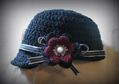 Everyday Handmade: The Bobbi Hat - Free Pattern News Boy Hat - has both adult and child sizes, and I like the simple button-center flower she uses (pattern for it shown as well)
