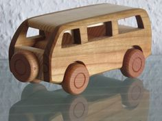 NEW - not available in stores!  Minibus A beautiful, extremely realistic, stable model car made of natural wood / solid wood true craftsmanship!  A sturdy, handmade car model with long life duration and value  The car was made very carefully, there are no sharp edges or rough place.  Vehicle with rotating wheels  Size / Dimensions  Length 16,5 cm, height 7 cm  WARNING! NOT SUITABLE FOR CHILDREN UNDER 3 YEARS OF AGE. Contains small parts and/ or small parts that can be torn of...