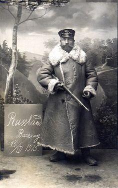 Studio portrait of Landsturmmann Schmalz wearing a heavy, woollen Petzmantel or overcoat, Brzeziny 13 March 1915