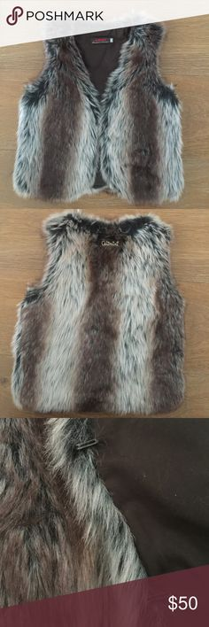 Catimini Faux Fur Vest Stylish Faux Fur vest by French boutique Catimini in girls size 6.  Brown lining with two large hooks and logo label on back. Like new. Catimini Jackets & Coats Vests