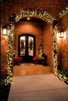 Bright & inviting X-mas decorations surrounding your front door should symbolize the warmth within ;))