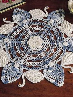 Six Swans A-Swimming crochet mat. Made this and starched stiffly to hang, but…