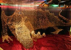Suspended Dragon Made of 40,000 Golden Buttons.........