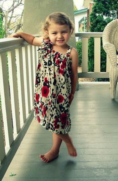 I made this dress last summer for my daughter following this tutorial... super cute and took less than an hour to make! Now that's my kind of dress!