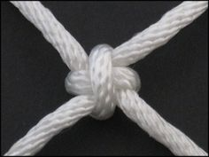 Cross Knot.. Cross on one side, square on the other.. String them up in a row..