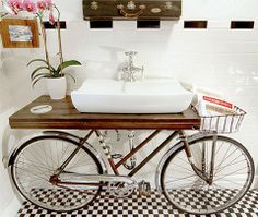 Unique Bicycle Bathroom  Unique #bathroom vanity. #Bicycle basket holds towels and other items. Creative bathroom designed by New Orleans based artist Benjamin Bullins.