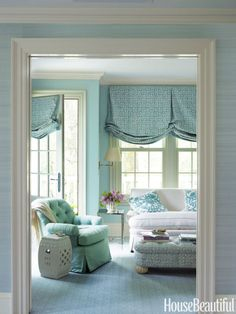 Soft blues lend an inviting calmness to the master bedroom's sitting area…
