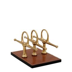 The Eichholtz Parmentyer tan letter rack makes the perfect equestrian themed gift or home accessory.