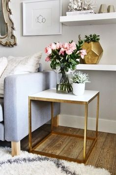 Such a fun Ikea hack. This side table painted gold and white is so chic.
