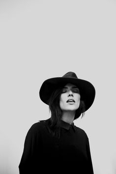 wide brimmed hat + all black