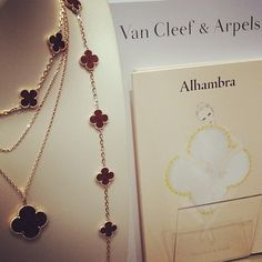 The Van Cleef and Arpels Alhambra Letter Wood Collection, set in 18k pink gold! Available at London Jewelers!