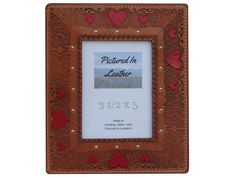 "$38  A 3 1/2""x5"" leather picture frame embossed with a heart design. This frame has hand painted red hearts and is a beautiful tan. It has a Plexiglas and an easel back. Perfect leather gift for that special someone!"