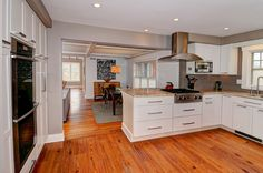 Magnificent kitchen which is open up to dining and living spaces! The open floor plan provides the perfect environment to entertain and enjoy with friends or family! #126saintjohnsroad #ridgefieldct #thechipneumannteam #neumannrealestate #ctrealestate #ctlistings #beautifulhomes #beautifulkitchens