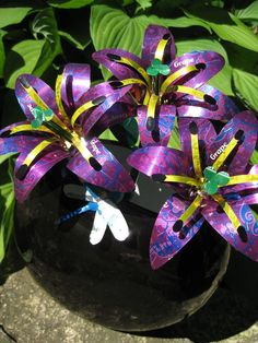 Recycled Pop Can Lilies-purple by Christine-Eige on DeviantArt Aluminum Can Flowers, Aluminum Can Crafts, Metal Crafts, Soda Can Flowers, Tin Flowers, Flowers Garden, Pop Can Art, Pop Can Crafts, Recycle Cans
