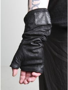 "Gee. Nothing says ""I mean business"" like a single leather glove. We got a BADASS over here."