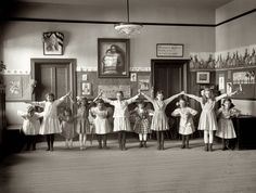 Dance Class: 1919 From Shorpy    My comment:  Notice a picture on the wall of the blessed virgin mother and Jesus along with a picture of a US president with the American flag drapped over the frame!