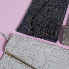 IMAN leather clutches