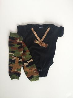 Camouflage Duck Call Hunting Onesie with Camo Baby Leg Warmers. For when baby is geared up to watch Duck Dynasty with mom and dad.