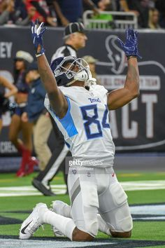 Tennessee Titans Wide Receiver Corey Davis celebrates a touchdown reception during the football game between the Tennessee Titans and Houston Texans on November 2018 at NRG Stadium in Houston,. Get premium, high resolution news photos at Getty Images Tennessee Titans Football, Nfl Football, Nrg Stadium, Nfl Uniforms, Remember The Titans, Wide Receiver, World Of Sports, Houston Texans, National Football League
