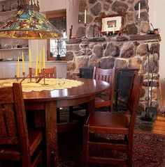 A Gustav Stickley dining table and 16 matching chairs are lit by a Tiffany fixture. As in Stickley's own home, the furnishings and architectural materials such as the stone fireplace are the décor; there is no applied decoration. Craftsman Dining Room, Craftsman Furniture, Arts And Crafts House, Home Crafts, Mission House, Architectural Materials, Craftsman Style Homes, Home Art, Dining Table